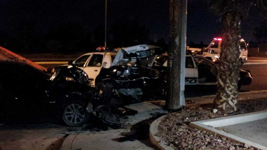 Two Metro police vehicles were damaged when a BMW slammed into the cars early Friday. (Arron Healy/FOX5)