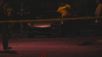 Police investigate the crash that killed Faith Love on Oct. 31, 2011