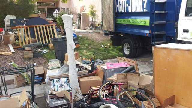 "A cleanup crew with three trucks is tacking what Metro police called ""the worst case of hoarding we ever seen."" (Christian Cazares/FOX5)"