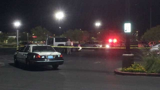 Police tape off a section of a Wal-Mart parking lot where a body was found inside a car. (Peter Dawson/FOX5)