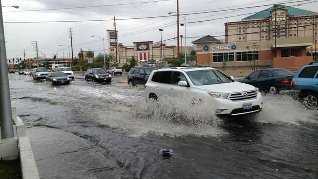 Motorists dredged through high water on Boulder Highway. (Christian Cazares/FOX5)