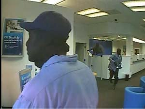 Surveillance still of the robbery (Henderson PD)