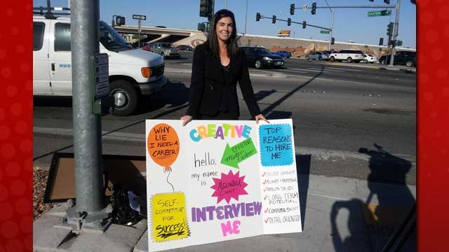 Alexandra Goot holds her poster, trying to catch eyes with big letters and reasons to hire her. (Elizabeth Watts/FOX5)