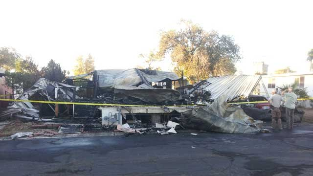 A mobile home was left in ruins after a fire at a trailer park in east Las Vegas. (Peter Dawson/FOX5)