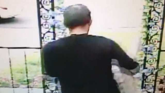 The man is then seen leaving with the 100 lb. statue. (Surveillance video provided to FOX5)