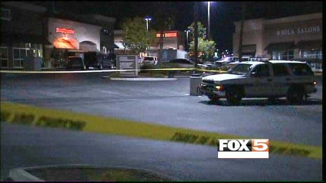 Police canvass a shopping center after a shooting near Eastern Avenue and St. Rose Parkway. (Armando Navarro/FOX5)