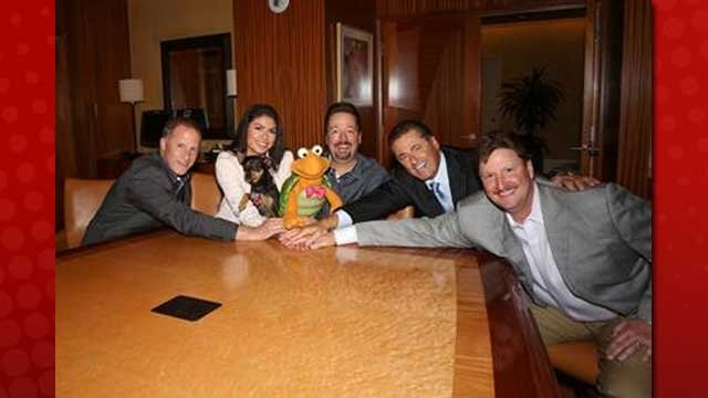 Terry Fator, center, flanked by his wife, Taylor, Mirage executives and Winston the Impersonating Turtle. (Provided by Mirage Hotel and Casino)