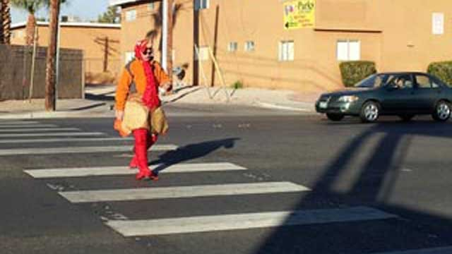 An officer in a turkey suit walked across a cross walk in a similar event last year.