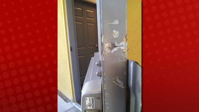 A security door is left broken after a burglary early Wednesday. (Christian Cazares/FOX5)