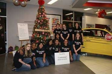 "First place winners Centennial High School transformed a Fiat into a ""school bus"" as part of its ""Teachers Rule"" tree."