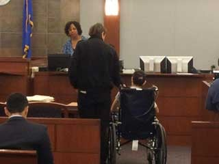 The victim in the accident appeared during a hearing in a wheelchair.
