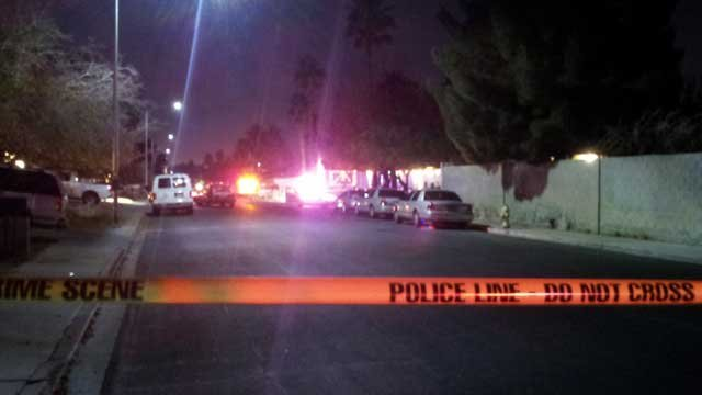 Police tape off a northeast Las Vegas neighborhood after a triple shooting. (Arron Healy/FOX5)