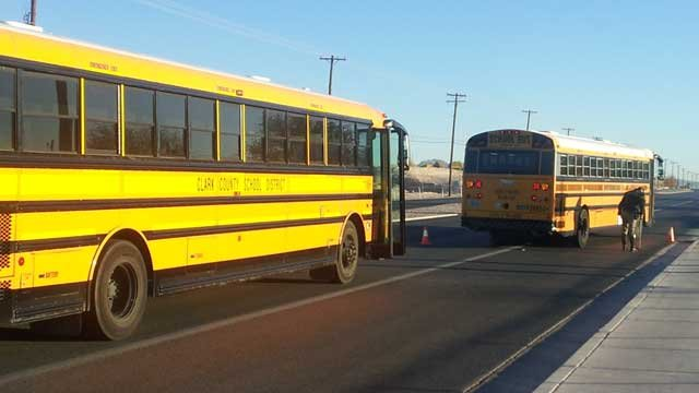 Two Clark County school busses stop near Las Vegas Boulevard North and Cheyenne Avenue. (Dave Lawrence/FOX5)