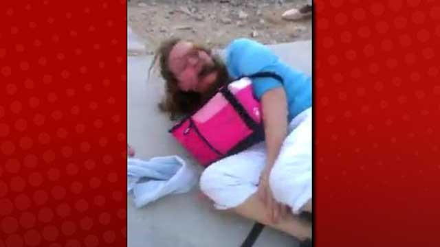 A 12-year-old girl was shown being attacked at a bus stop. The video of the attack was posted on Friday. (Video screen capture)