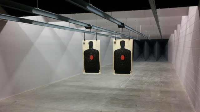 Paper targets hang in the shooting alley at Strip Gun Club. (Armando Navarro/FOX5)