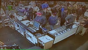 Surveillance still from inside the gun store. (David Famiglietti)