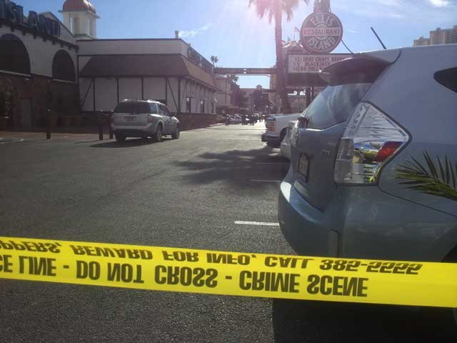 Police taped off a parking lot on Koval Lane after a shooting. (Christian Cazares/FOX5)
