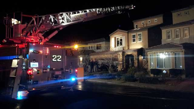 Clark County Fire Department mop up after a fire at a three-story home near Blue Diamond and Fort Apache roads. (Peter Dawson/FOX5)