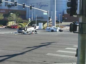 A vehicle rested on its roof following a deadly crash on Flamingo Road and Wynn Road on Jan. 1. (Joe Lybarger/FOX5)