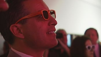 Gov. Brian Sandoval looks at a 3D television during his tour of CES 2013