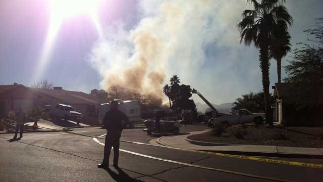 Smoke billows from the scene of a fire where a reported homicide took place.  (Courtesy: Marquela Waldo)