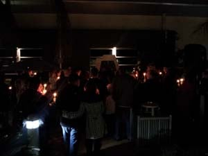Mourners gather to remember Kathryn Michelle Walters and Max Walters on Thursday night. (Doug Johnson/FOX5)