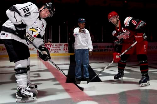 Former UMC patient Keiontae Williams drops the puck. (Photo by John Bosworth)