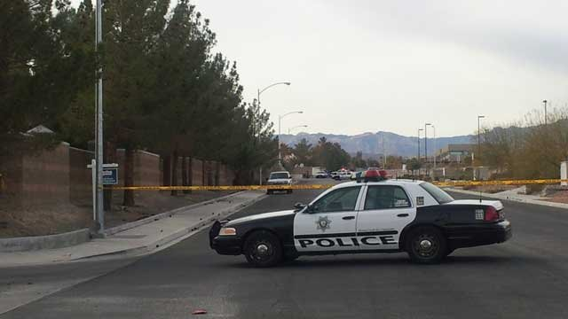 Police tape off a neighborhood following an officer involved shooting on Feb. 2, 2013. (Christian Cazares/FOX5)