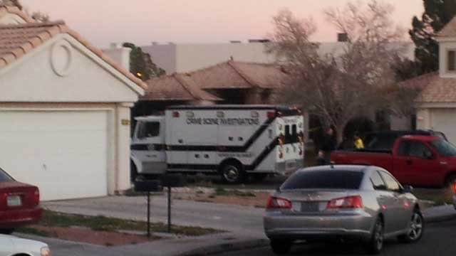 A crime scene investigations vehicle was parked next to a home where a body was found in a fire on Feb. 5, 2013.(Dave Lawrence/FOX5)