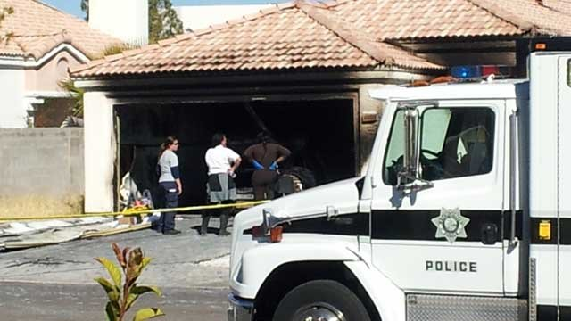 Police investigate a burned out garage where a body was found on Feb. 5, 2013. (Christian Cazares/FOX5)