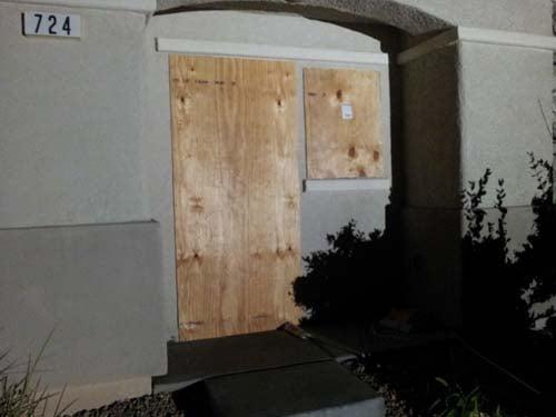 Dorner's house is boarded up Thursday evening. (Jason Westerhaus/FOX5)