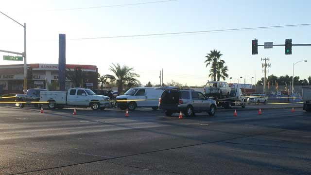 Police closed off a section of Nellis Boulevard near Owens Avenue after the deadly wreck. (Eric Youngman/FOX5)
