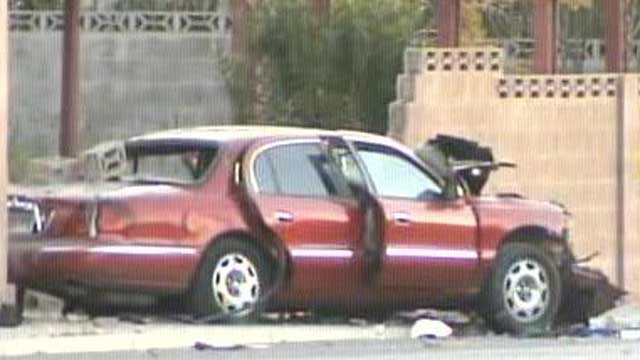 Police said two people were inside a vehicle that crashed into a wall near Flamingo Road and Decatur Boulevard on Feb. 18, 2013.