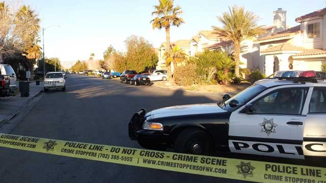 Police tape off a neighborhood near Silverado Ranch Boulevard and Maryland Parkway. (Armando Navarro/FOX5)