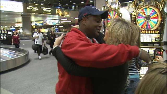 Wiley hugs his wife upon his arrival at McCarran Airport on Feb. 19, 2013.