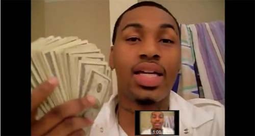 Ammar Harris shows off his cash in a video he posted. (LVMPD)