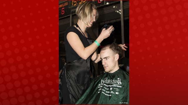 Forward Scott Pitt gets a close shave. (Photo by Angela Cripps)