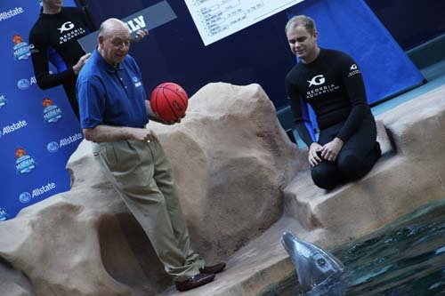 Broadcasting legend Dick Vitale and sports-predicting dolphin. (Taylor)