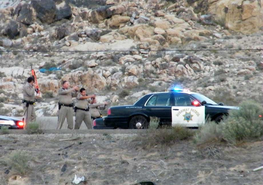 Ex-Nevada Assemblyman Steven Brooks, middle right, who led police on a chase from Barstow, Calif., until his tires were spiked in Victorville, Calif., is apprehended by police, Friday, March 29, 2013, in Victorville, Calif. (AP Photo/Jennifer Simpson)
