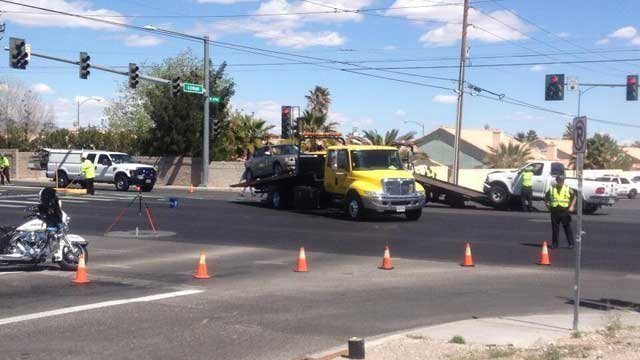 Tow trucks haul a car and a pick-up truck after a deadly wreck at Gowan and Decatur. (Jason Valle/FOX5)