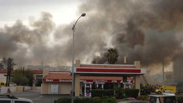 Heavy smoke blanket an area east of the Las Vegas Strip as the Key Largo hotel property burned on March 28, 2013.