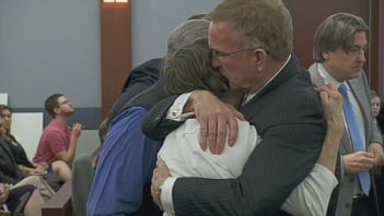 Attorney Robert Eglet hugs the plaintiffs following the verdict on Thursday.