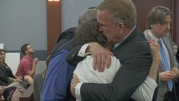 Attorney Robert Eglet hugs the plaintiffs following the verdict on April 4, 2013.