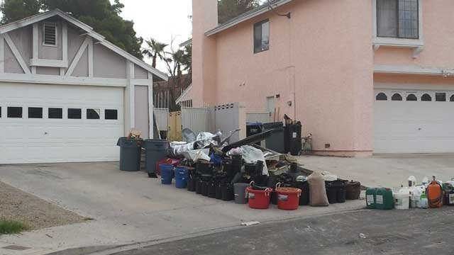 Piles of material from the grow house sit curbside. (Armando Navarro/FOX5)