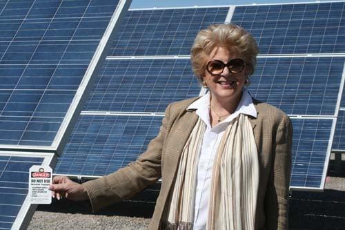 Goodman poses will the solar panels. (Courtesy: City of Las Vegas)