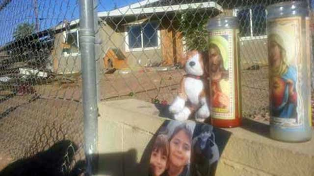 A memorial was set up next to the home where a fire claimed a child on May 2, 2013. (Dave Lawrence/FOX5)