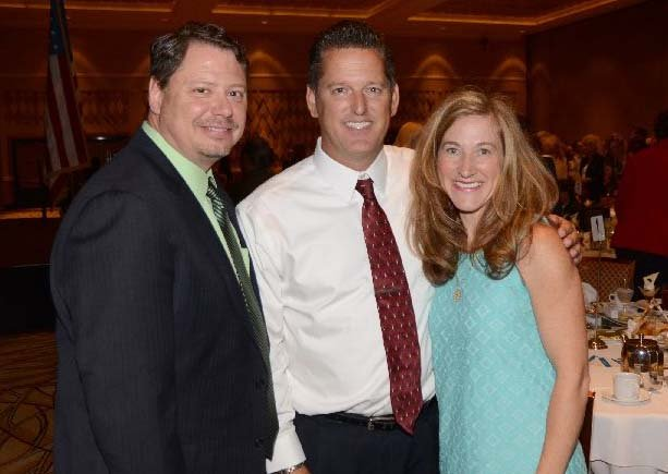 Maggie Reardon with CCSD Interim Superintendent Pat Skorkowsky (left) and Rogers Elem. Principal Kip Krzmarzick. (CCSD)