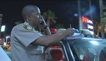 Officer Gerald Jackson writes a citation for an 18 year-old in possession of alcohol.