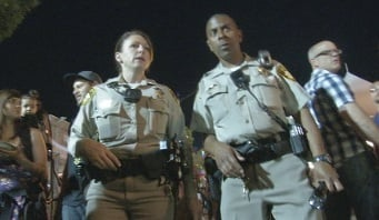 Officers Cynthia Williams (left) and Gerald Jackson (right) patrol First Friday.