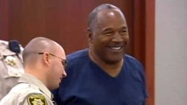 O.J. Simpson smiles as court takes a recess. (May 14, 2013/FOX5)